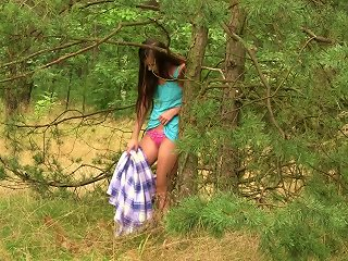 Slim Brunette Chick Fingers Her Pussy In The Forest