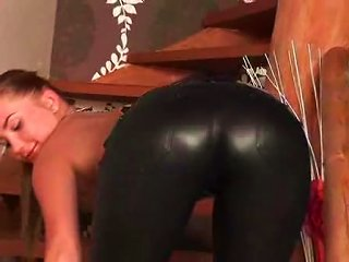 Beautiful  Girl In Leather Pants Teases